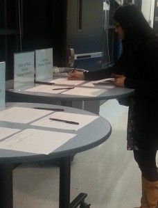 A woman signs up for a committee to help plan the new DeBakey.