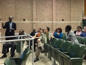 Community members discuss plans for Young Men's College Preparatory Academy at a meeting on Thursday night at the school.
